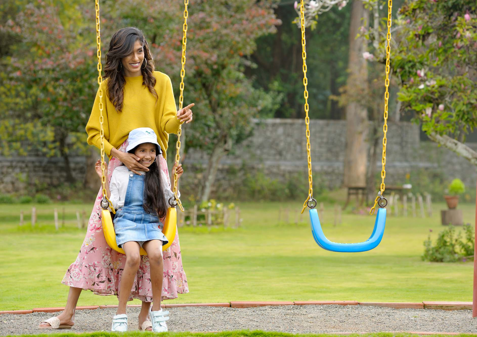 happy-mother-daughter-laughing-and-playing-swing-in-a-park