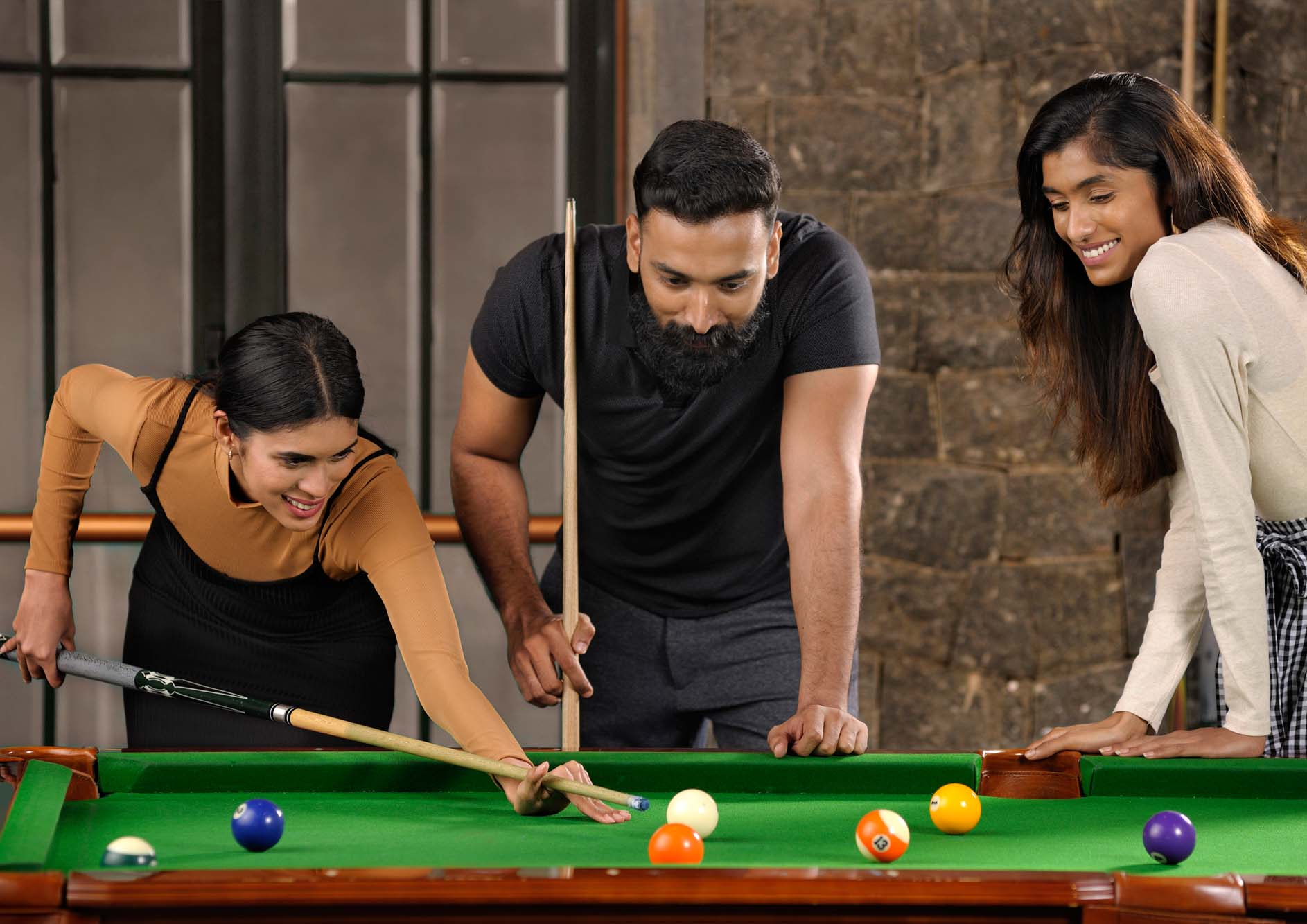 friends-playing-billiards-at-the-tamara-kodai
